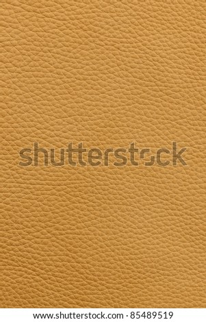 Yellow or light brown natural leather background or texture close up - stock photo