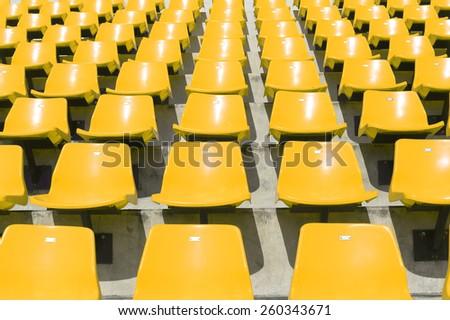 Yellow outdoor sport chair in stadium. - stock photo