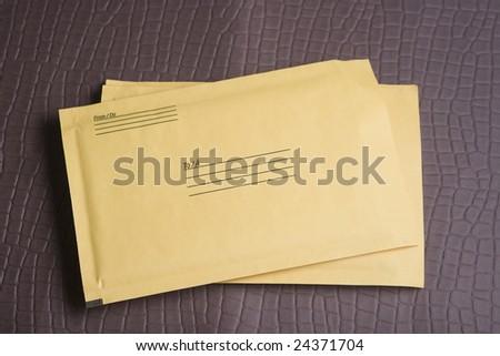 Yellow packaging envelope - stock photo