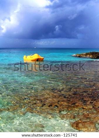 yellow paddle boat - stock photo