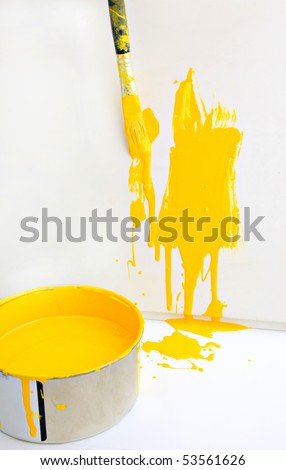 yellow paint and old used brush shallow dept of field - stock photo