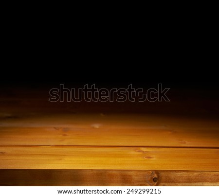 Yellow paint coated wooden boards copyspace background composition with the low key lighting - stock photo