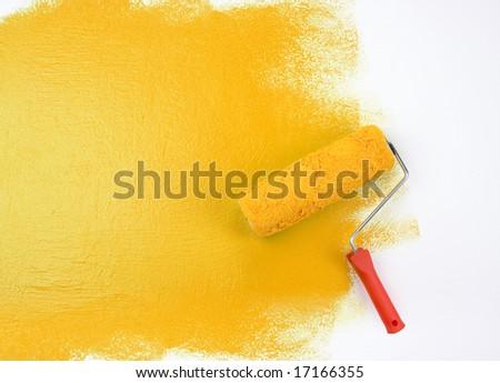 Yellow paint roller - stock photo