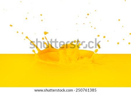 yellow paint splashing isolated on white - stock photo