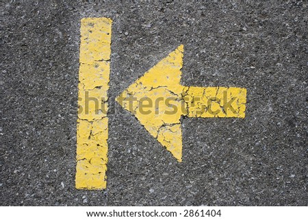 yellow painted arrow