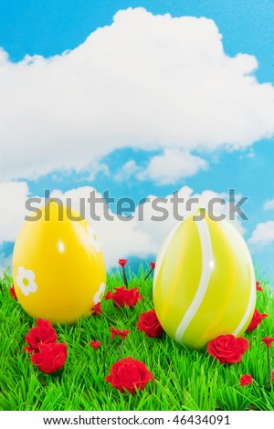 Yellow painted easter eggs in the grass