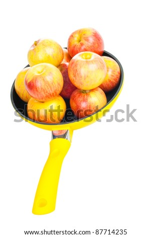 Yellow pan with apples isolated on white background - stock photo
