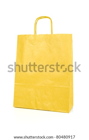 Yellow paper bag isolated on white background. - stock photo