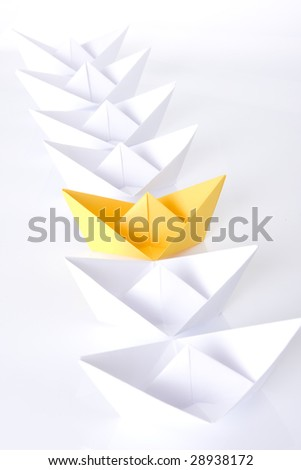 Yellow paper boat in queue