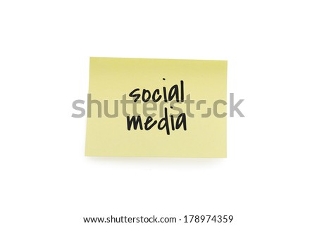 Yellow paper note with the words social media, isolated on white background