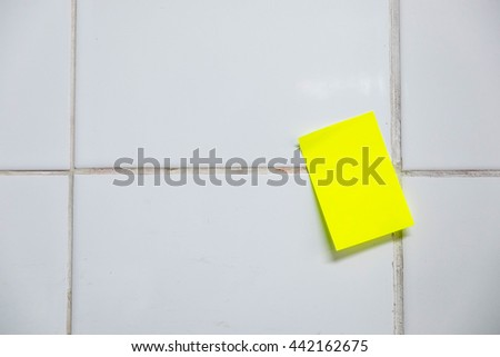 Yellow Paper notes on a white wall. - stock photo