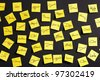 Yellow paper notes with male and female names - stock photo
