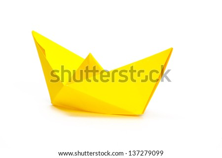 Yellow paper ship on a white background