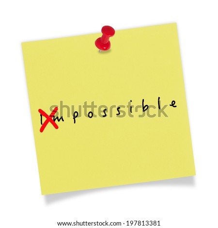 Yellow paper with red pin on white background. Changing the word impossible to possible. - stock photo