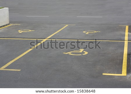 Yellow parking sign for handicapped people - stock photo