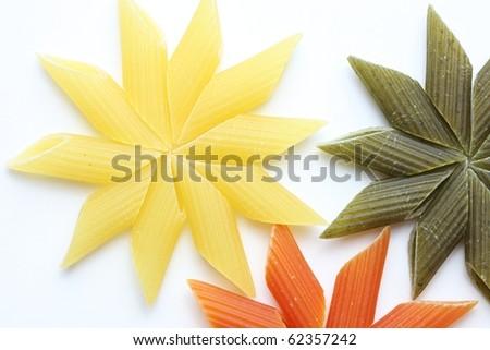 Yellow pasta flower isolated on white - stock photo
