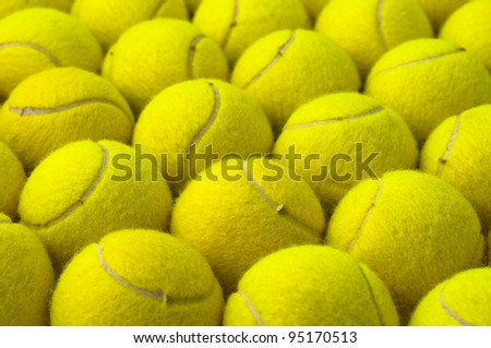 Yellow pattern, made with tennis balls, placed in rows - stock photo