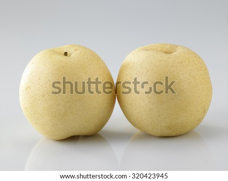 Yellow pear isolated on white background - stock photo