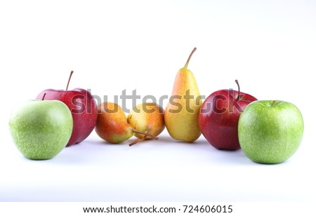 Yellow pears, red and green apples on a white background isolated for designer
