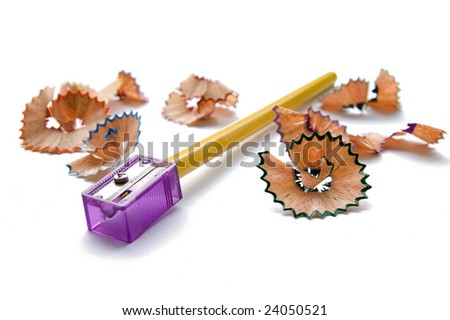 Yellow pencil and purple sharpener isolated on white - stock photo