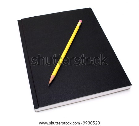 yellow pencil over a black notebook - stock photo