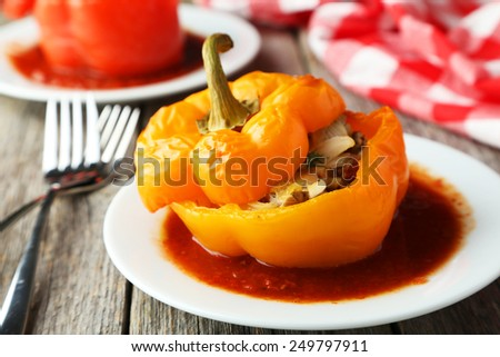 Yellow pepper stuffed with meat, rice and vegetables - stock photo