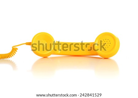 Yellow phone isolated over white background - stock photo