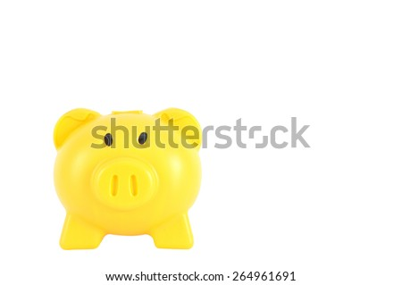 Yellow piggy bank isolated on white background, clipping path included. - stock photo