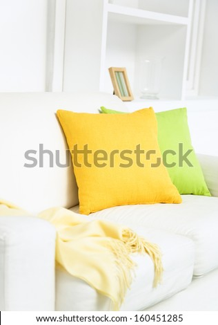 yellow pillow and sofa, interior living room - stock photo