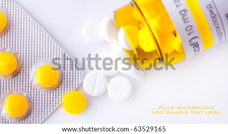 yellow pills background conceptual image - stock photo