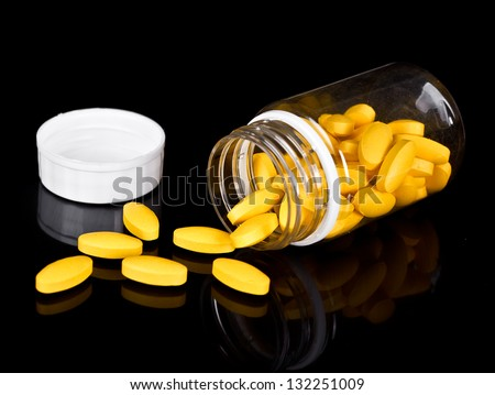 Yellow pills mainly made of caffeine which is known as fat burner or thermogenic, mainly used for gym enthusiasts. - stock photo