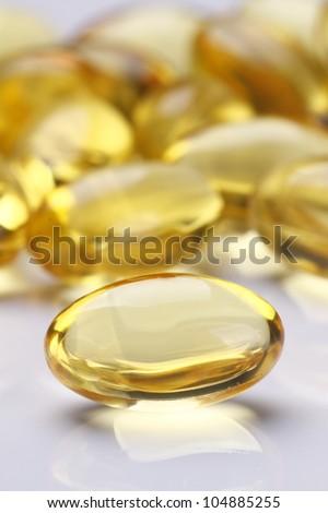 Yellow Pills Vitamin E Soft Gels - stock photo