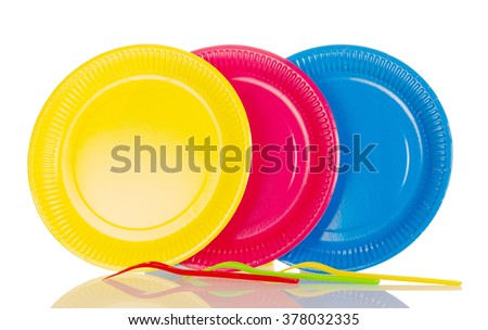 Yellow, pink, blue plastic plates isolated on white background - stock photo