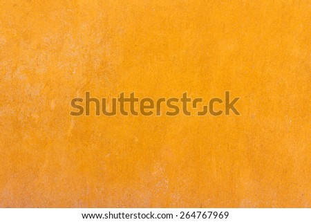 Yellow plastered wall in solid color - stock photo