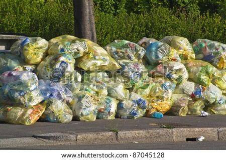 yellow plastic and aluminum bag ready for recycling - stock photo