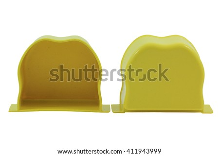 Yellow Plastic box for bird food on a white background - stock photo