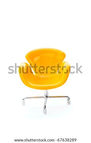 Yellow plastic chair for doll - stock photo