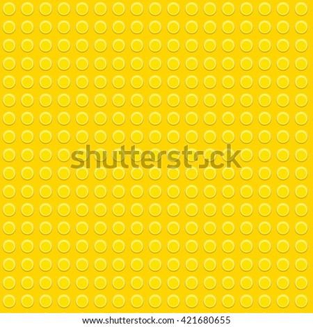 Yellow plastic construction block pattern - stock photo