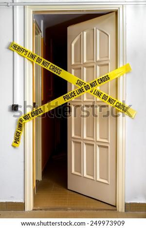 Yellow Plastic Crime Scene Do Not Cross Tape - stock photo