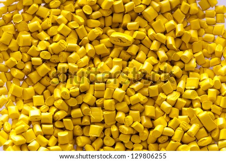 Yellow plastic granules - stock photo