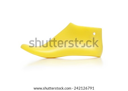 Yellow plastic last shoe rough surface from use on white background, (with clipping path) - stock photo