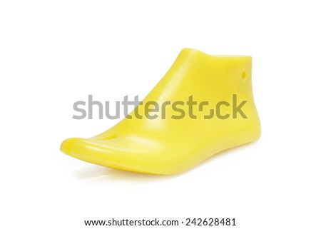 Yellow plastic last shoe rough surface from use on white background, (with clipping path)