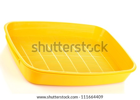 Yellow plastic litter cat isolated on white - stock photo
