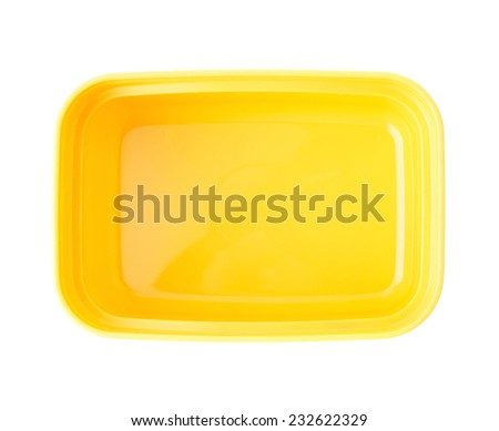 Yellow plastic tableware food container isolated over the white background - stock photo