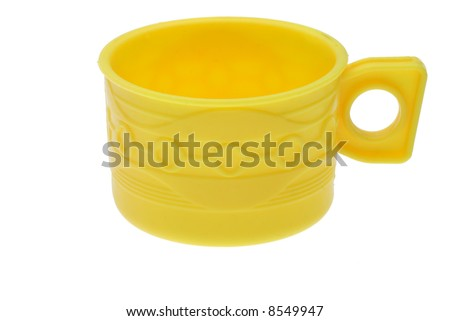 yellow plastic toy cup on white