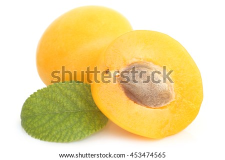 Yellow plums with green leaf on white background    - stock photo