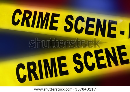 yellow police crime scene tape on red and blue background - stock photo