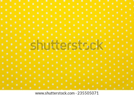yellow polka dot fabric - stock photo