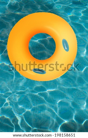 Yellow pool float/ring in blue swimming pool. - stock photo