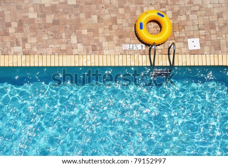 Yellow pool ring / float room for your text - stock photo